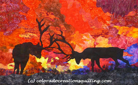A silhouette of majestic elk as they clash antlers with a beautiful sunset in the background.  Quilt pattern available at Colorado Creations Quilting