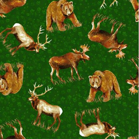 This fabric features elk, moose, and bear on a green background with paw prints.  Cotton Fabric available at Colorado Creations Quilting