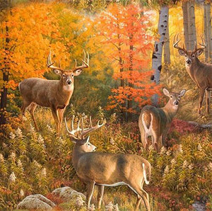 Realistic deer in their natural habitat surrounded by autumn-colored trees and ground cover cotton fabric.