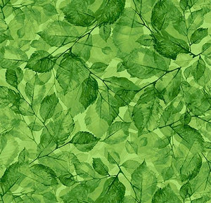 Green leaves on a green background are featured in this Timeless Treasures fabric.