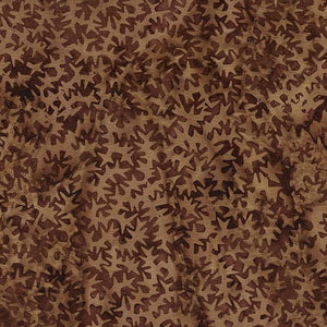 This brown tonal fabric features geometric spike shapes by Island Batiks. Available at Colorado Creations Quilting