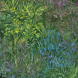 Delicate wildflowers in yellows, blues and purples on a field of green of batik fabric by Island Batiks. Available at Colorado Creations Quilting