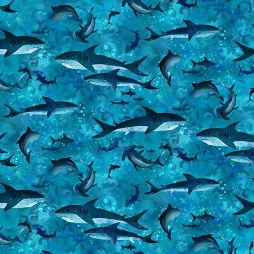 Blue tonal cotton fabric featuring sharks available at Colorado Creations quilting