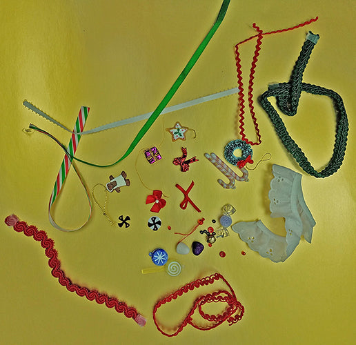 Display of beads, buttons, jingle bells, ribbons, trims, lace miniature ornaments, bows and candy canes, green, red, white for the Sugar & Spice quilt pattern by Colorado Creations Quilting