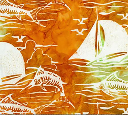 This cotton batik fabric features sailboats and marlin in rich orange and yellow. Available at Colorado Creations Quilting
