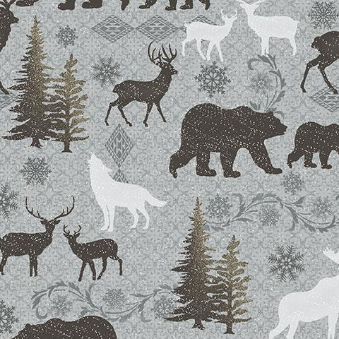 This 100% cotton fabric features silhouettes of wildlife like bears, deer, moose and coyotes on a gray background.