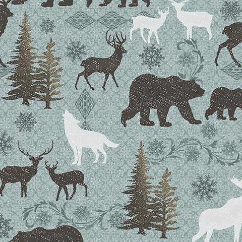 This 100% cotton fabric features silhouettes of wildlife like bears, deer, moose and coyotes on a muted turquoise background.