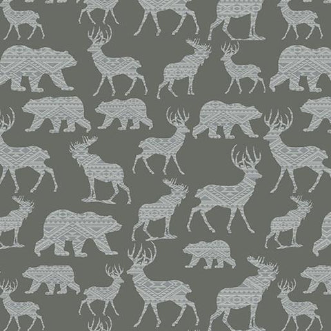 This 100% cotton fabric features silhouettes of wildlife like bears, deer, moose in light gray on a medium gray background.