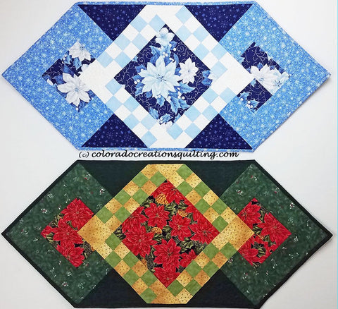 Blue Christmas quilt table runner has blue pointsettias in the center square with blue and white checker board surrounding it along with a few more borders available at Colorado Creations Quilting