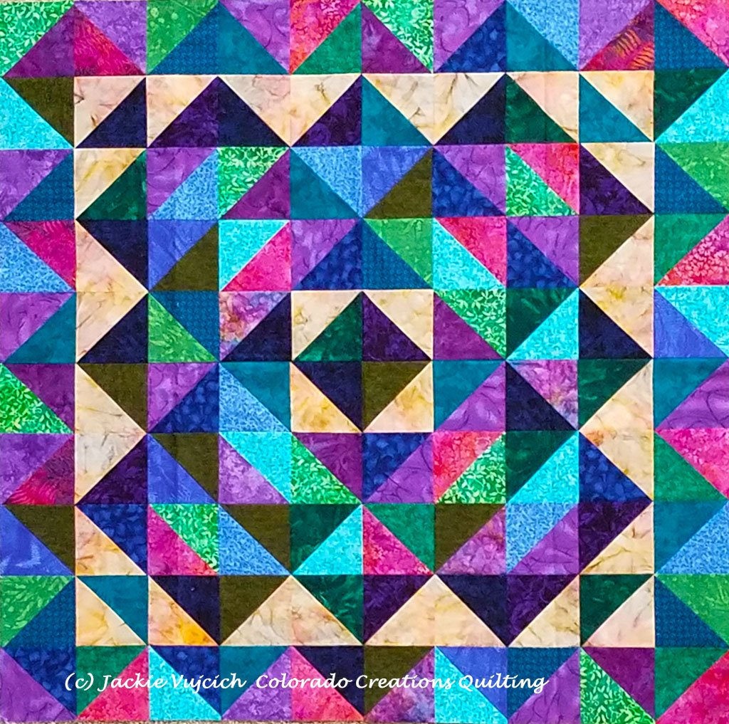 At a Crossroads quilt in blue-purple green colorway using triangles available at Colorado Creations Quilting