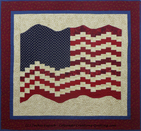 Bargello (USA) Flag on a background of cream with blue and red surrounding borders by Colorado Creations Quilting