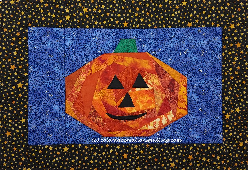 Orange Jack O'Lantern on a blue gackgraound placemat