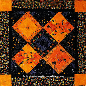 Fright Night quilt has four pieced orange squares on point with alternating black pieced squares available at Colorado Creations Quilting