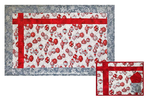 Table runner and placemat; silver ornamentson white with red accent and sliver borders.  Placemat has red napkin.