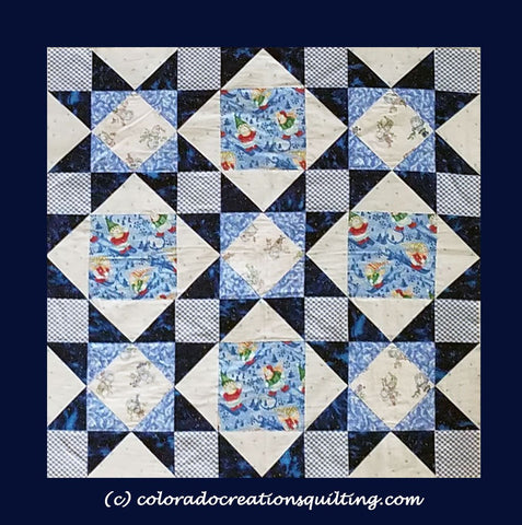 Quilt shows star and diamond blocks with snowmen in the center of the quilt blocks