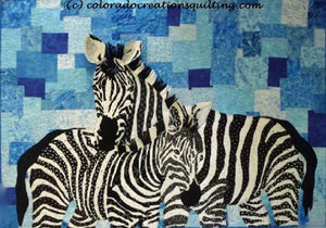 A pair of zebras on a blue background.  Quilt pattern available at Colorado Creations Quilting