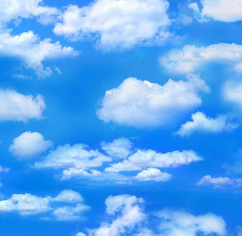 Deep blue sky with large white clouds cotton fabric for quilting and craft projects.