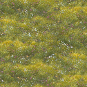 Spring green grass with clumps of small wildflowers, cotton fabric by Quilting Treasures