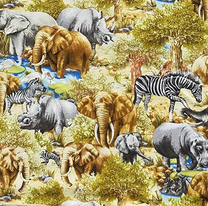 This fabric features elephants, zebras, rhinos and hippos on an African meadow of wild grasses.