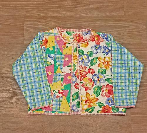 This darling quilted one of a kind jacket (front sidein florals and pastels will definitely make a statement! Available at Colorado Creations Quilting