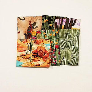 This bundle of cotton fat quarters has a selection of images including cacti and blooming flowers, sunsets, wildlife and mountains.