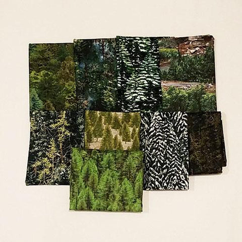 This cotton fat quarter bundle has a selection of evergreen trees.
