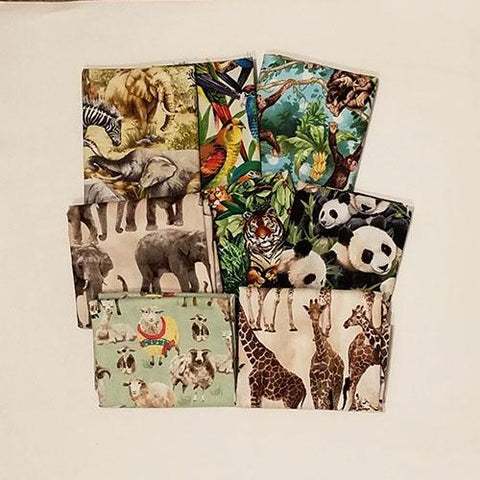 This cotton fat quarter bundle has a selection of exotic animals you wouldn't normally see in North America like giraffes, elephants, tigers, monkeys and sloths!