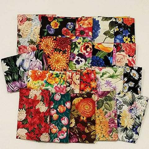This fat quarter bundle has a selection of garden-variety flower cotton fabrics like pansy, iris, sunflower, daisy, hydrangea and geranium
