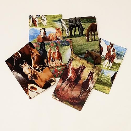 This bundle of fat quarters features a selection of horses both tame and wild and in their natural habitat grazing and galloping.