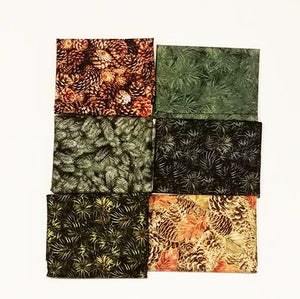 This bundle of fat quarters features a selection of pine cones and evergreen boughs.