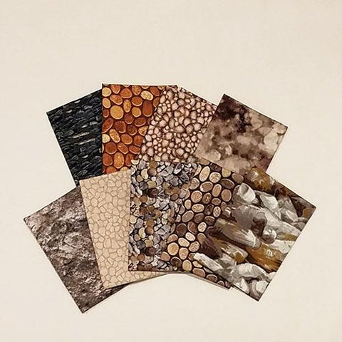 This fat quarter bundle has a selection of rock cotton fabrics from pebbles to boulders in shades of brown and gray