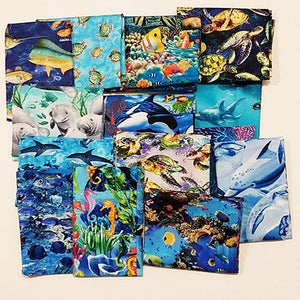This cotton fat quarter bundle has a selection of sea life fabrics like dolphins, sharks, tropical fish, manatees and sea horses.
