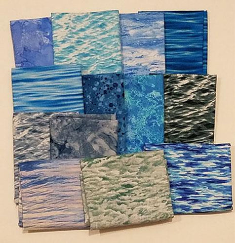 This fat quarter bundle has a selection of water cotton fabrics in bright blues and some with waves!