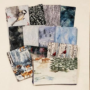 This bundle of fat quarters features a selection of snow related fabrics such as snow-ladened trees and forests as well as snow flakes.