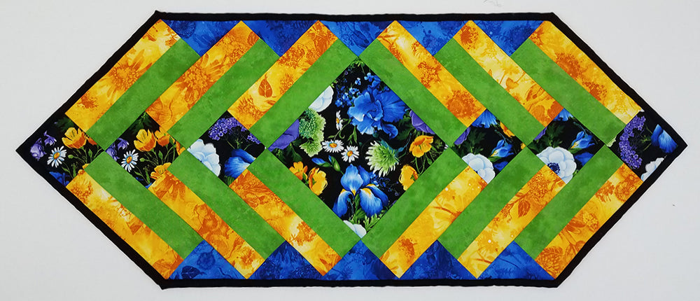 Fun and Done Table Runner display of all fabrics needed for the quilt pattern available at Colorado Creations Quilting