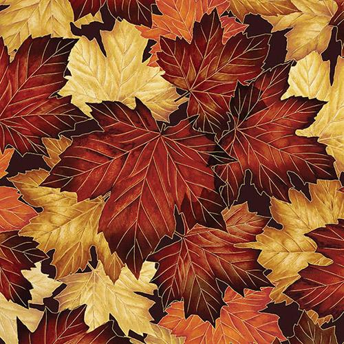 Packed maple leaves in shades of red and gold