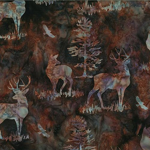 This batik cotton fabric features deer and buck on a darker brown background. Available at Colorado Creations Quilting