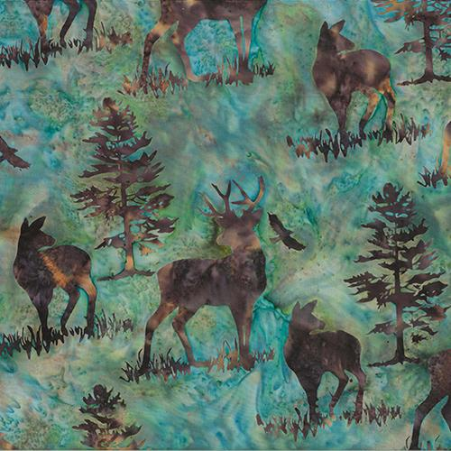 This batik cotton fabric features deer and buck on a teal blue background. Available at Colorado Creations Quilting