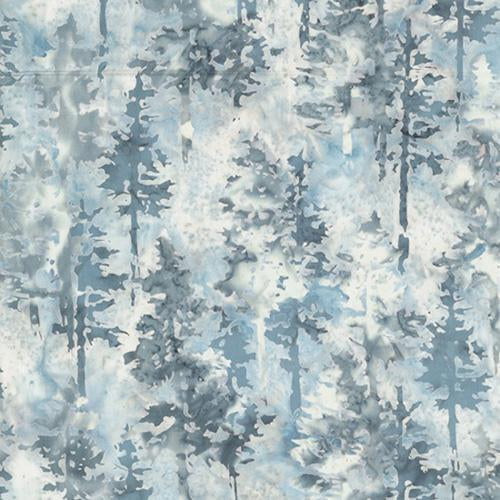This batik cotton fabric featuring evergreens in shades of blue and gray on a light gray background. Available at Colorado Creations Quilting