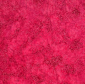This dark pink tonal fabric shows tossed seeds or rice images by Island Batiks. Available at Colorado Creations Quilting