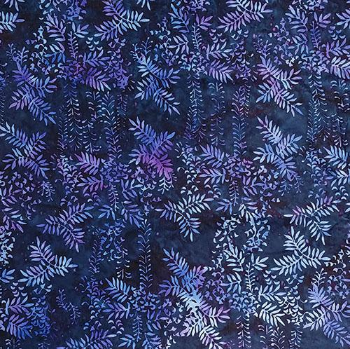 This batik cotton fabric features leafy vines on a navy background.