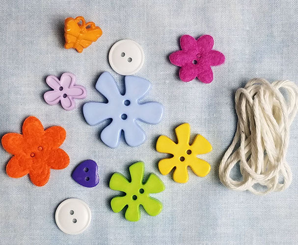 Image of 10 floral/novelty  buttons and cording to enhance the Happy Camper sewing machine cover.  Available at Colorado Creations Quilting