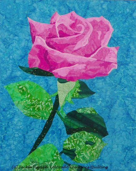Fabric kit displays of all pink, green and blue fabrics needed to complete Rose by Another Name quilt pattern available at Colorado Creations Quilting