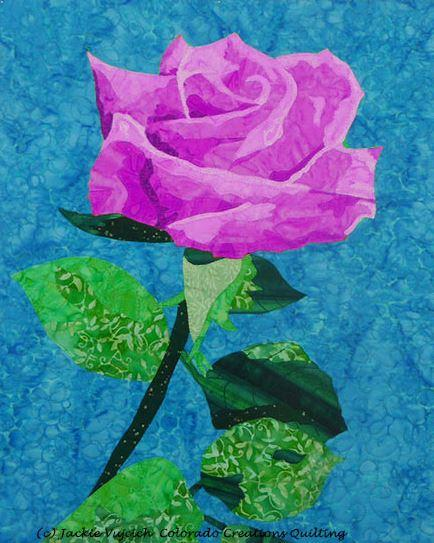 Fabric kit displays of all violet (purple), green and blue fabrics needed to complete Rose by Another Name quilt pattern available at Colorado Creations Quilting