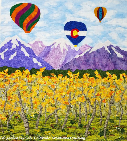 Soaring Over the Rockies quilt kit display of all landscape fabrics needed for the quilt pattern available at Colorado Creations Quilting