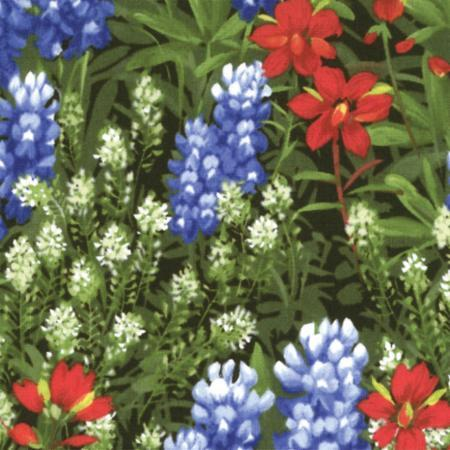 multi-colored wildflowers on green grass fabric available at Colorado Creations Quilting