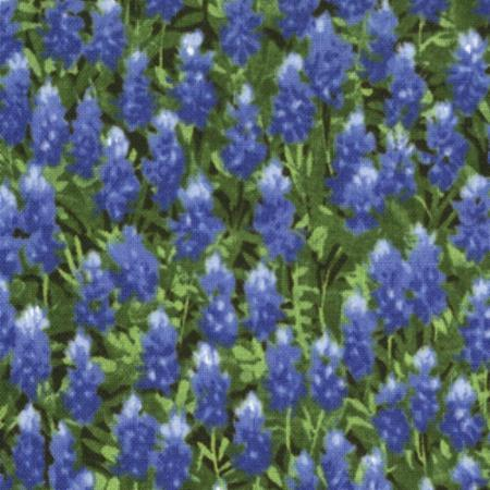 Bluebonnet wildflowers on green grass fabric available at Colorado Creations Quilting