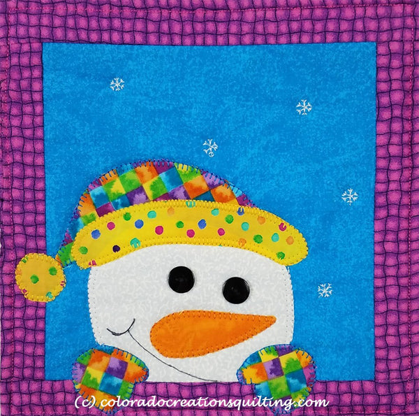 Snowman appliqued on a quilted square to hold your coffee cup