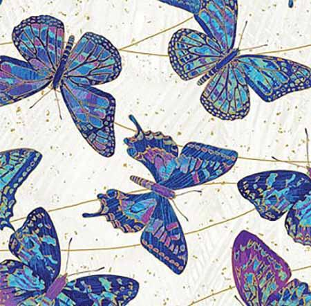 This cotton batik fabric features vibrant blue and purple butterflies in flight on a white background. Available at Colorado Creations Quilting
