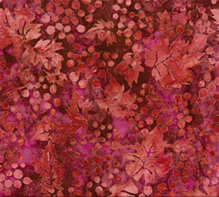 This cotton fabric in red features grapes and leaves available at Colorado Creations Quilting